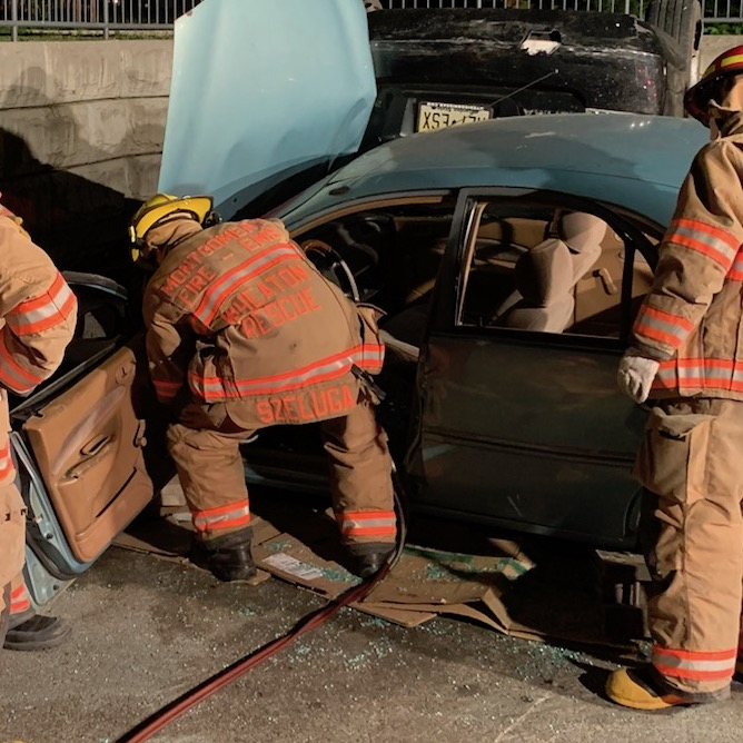 Firefighters cutting vehicle